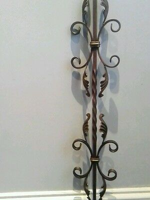 Set of ten wrought iron staircase spindles