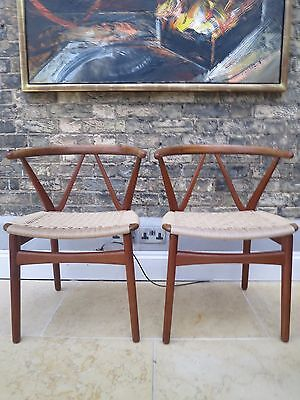 Pair Danish mid century Henning Kjaernulf teak chairs for Bruno Hansen retro