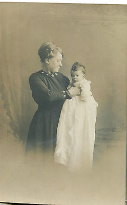 1900s Postcard Studio portrait of a mother and baby