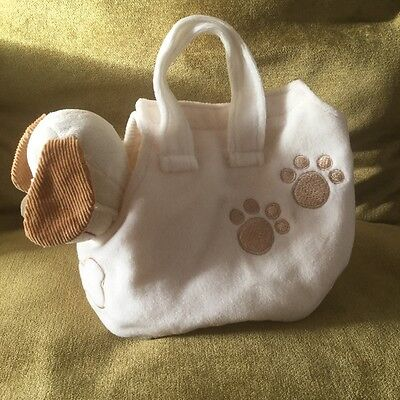 Small soft toy dog in carry bag
