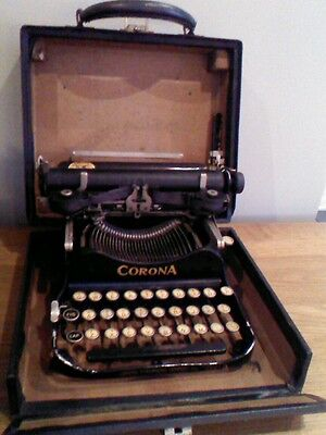 Vintage portable typewriter folding Corona
