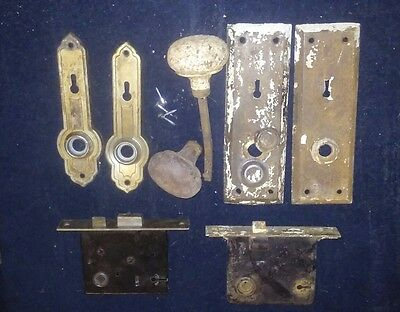 9 piece lot of antique door knobs latching mechanisms and key hole face plates