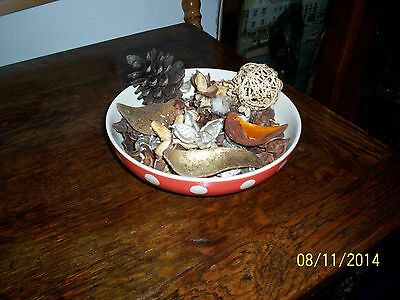 pot pourie bowl with dried leaves  cone shell and wicker ball