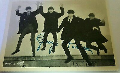 The Beatles signed black and white photo