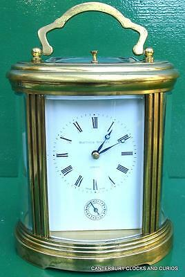 Matthew Norman Swiss Grande Oval Alarm Striking Repeater 8 Day Carriage Clock