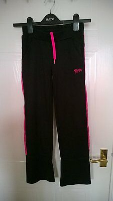 2pairs Lonsdale tracksuit bottoms 1 black, 1 grey age 7 -8 years