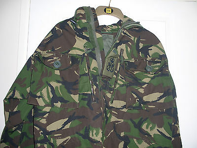 A Nato camouflage windproof hooded smock combat jacket