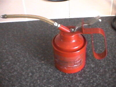 black spur red painted oil can one half a pint capacity