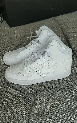 white nike high top sneakers