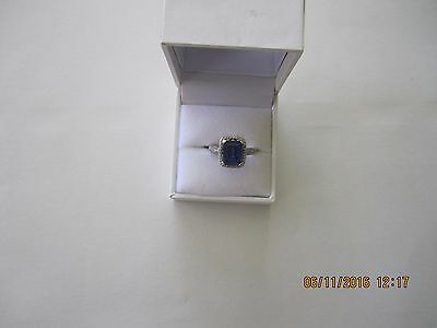9 CT White Gold with created Saphire and .50 CT Diamond ring