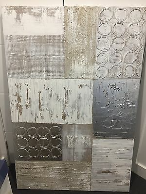 Large silver and gold abstract art piece on canvas