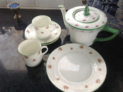china tea pot, 2 cups and saucers and a plate