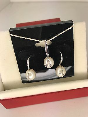 Cultured fresh water pearl earrings and pendant 14k white gold and diamonds