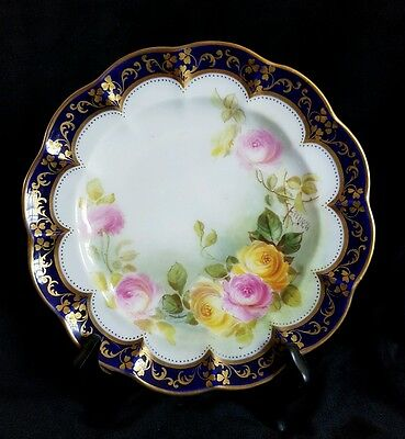 Small scallop edged china plate