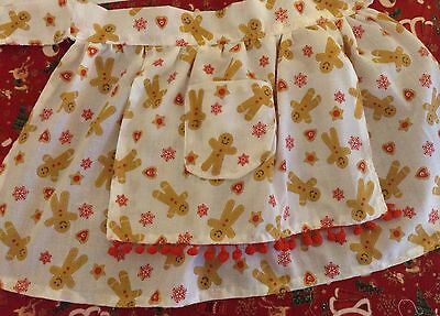 little girls christmas apron with gingerbread fabric, approx age 2-3 years