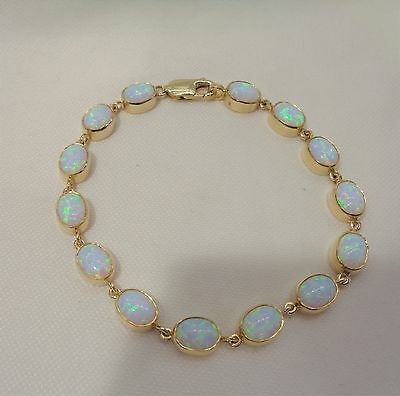 """9ct Gold Opal Bracelet in a rub over yellow gold setting  - 19.5cm  ( 7 1/2"""")"""
