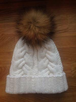 Very warm,  hand-knitted hat for kid