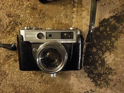 Yashica LYNX-5000 35mm film camera with leather case