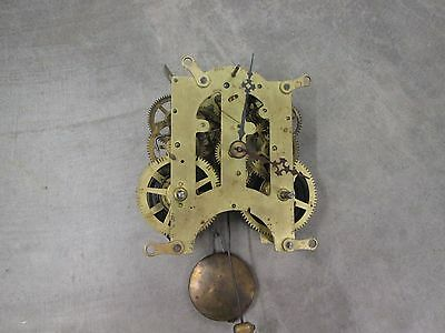 Old Ansonia Clock Movement 5 1/2 with hands, pendulum bob, for parts or repairs