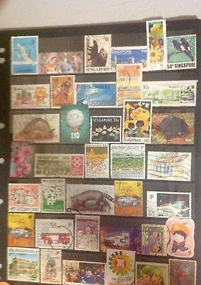 2 pages, Singapore, all different, used stamps, excellent.