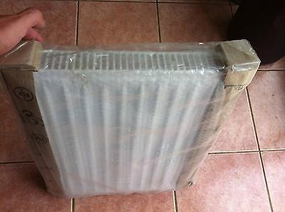 New single radiator with brackets in packaging - 400mm wide 500mm high