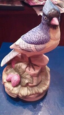 Beautiful Old piece porcelain Musicial Blue Jay Statue   turns around and plays