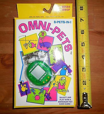 Vintage Omni-Pets 8 In 1 Keychain Pocket Game Rare ? Uncommon? Giga Like NR