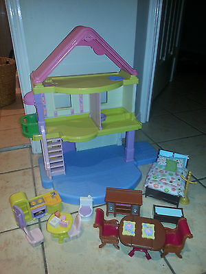 fisher Price doll house and loving family pieces
