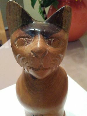 Two-toned wooden hand-carved cat figurine