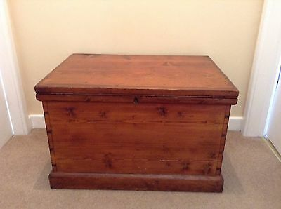 Antique pine bedding chest with original lock and key.
