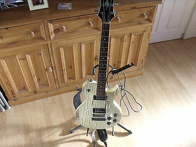 Spear RD Relic electric guitar with strap and stand