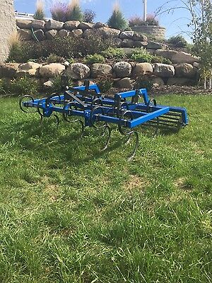 3 point field cultivator with rolling basket.