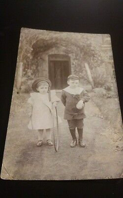 Old postcard posted 1905 small thimble postmark edwardian children with hoop