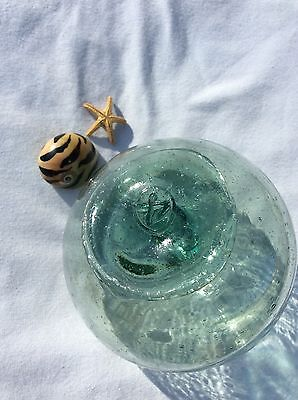 """glass fishing float, 3 and 1/2"""" marked Float"""