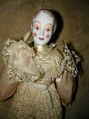 Vintage Porcelain Harlequin Doll In Pale Pink off White Satin Outfit Circa 1970s
