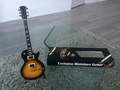 Miniature Gibson Guitar replica with stand