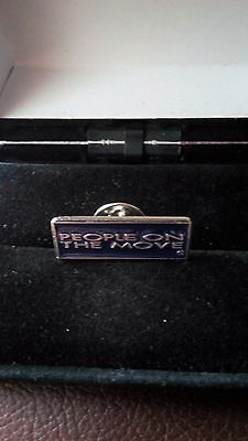 Badge (People On The Move)