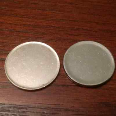 Pair (2) of RCM mystery blank Type 2 (rimmed) planchets (error), magnetic