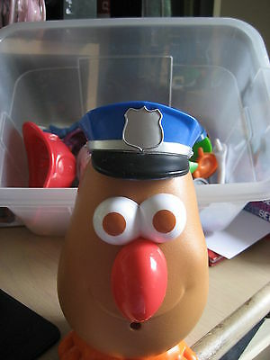 Mr. Potato head with assorted body parts and hats