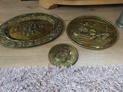 3 brass plaques