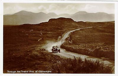 Real Photographic postcard of the Twelve Pins of Connemara showing vintage car