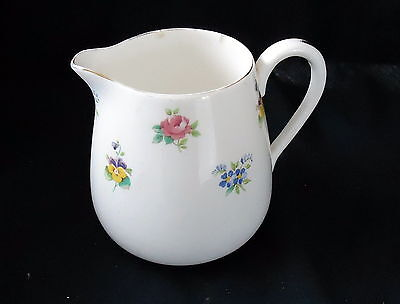 Royal Staffordshire Creamer With A Floral Design.