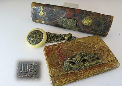 Two Japanese Leather Tobacco Pouches With Kagamibuta