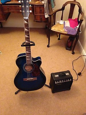 Lindo Blue Electric / Electro-Acoustic Guitar With Stand And Amp