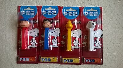 4 Peanuts Snoopy, Charlie Brown and Woodstock Pez collectable sweet dispensers