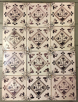 12 Nice Dutch Delft manganese 3-tulip Tiles, 19th century.