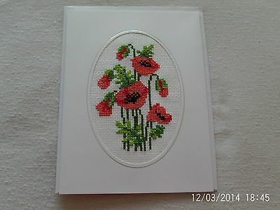 large completed cross stitch card poppies