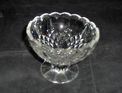 small cut glass bowl, with shaped top lip
