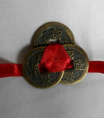 A Chinese I-Ching Coins tied with Red Ribbon, Feng Shui Lucky Charm wealth
