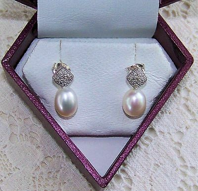 Stamped 925 Silver Diamond & Pearl Earrings with appraisal for $823